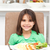 portrait of a little girl eating pasta and salad in the kitchen stock photo © wavebreak_media