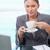 Portrait of a businesswoman drinking tea in her office stock photo © wavebreak_media
