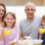 счастливая · семья · завтрак · кухне · дома · любви · фрукты - Сток-фото © wavebreak_media