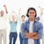 Close-up of a man crossing his arms with people raising their arms in background stock photo © wavebreak_media