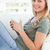 erschossen · lächelnde · Frau · Sitzung · Couch · Tasse - stock foto © wavebreak_media