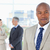 serious executive in a suit standing upright while his team is behind him stock photo © wavebreak_media