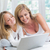 mother and daughter using laptop in the bed stock photo © wavebreak_media