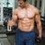 shirtless muscular man exercising with dumbbells in gym stock photo © wavebreak_media
