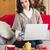 улыбающаяся · женщина · сидят · диване · гостиной · кредитных · карт - Сток-фото © wavebreak_media