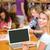 huiswerk · met · behulp · van · laptop · vergadering · vloer · computer - stockfoto © wavebreak_media