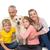 famille · heureuse · posant · caméra · étage · salon - photo stock © wavebreak_media