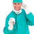 Positive surgeon holding a stethoscope stock photo © wavebreak_media