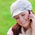 Attractive young woman wearing cap and scarf talking on phone on the grass stock photo © wavebreak_media