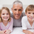 улыбаясь · отец · позируют · спальня · семьи - Сток-фото © wavebreak_media