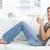 Frau · Sitzung · Couch · schauen · vorwärts · lächelnd - stock foto © wavebreak_media
