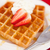 waffles with whipped cream and strawberry on it on a red napkin stock photo © wavebreak_media