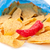 Open bag of crisps with a red pimento against white background stock photo © wavebreak_media