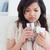 Sick woman holding a glass of water stock photo © wavebreak_media