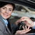 Smiling woman in a car receiving car keys in a car shop stock photo © wavebreak_media