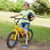 smiling boy riding bicycle at park stock photo © wavebreak_media