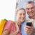 gelukkig · naar · smartphone - stockfoto © wavebreak_media