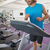 smiling man running on treadmill in gym stock photo © wavebreak_media