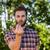 hipster smoking an electronic cigarette stock photo © wavebreak_media