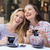 happy women friends talking and laughing together stock photo © wavebreak_media