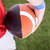 american football player holding the ball stock photo © wavebreak_media