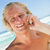 Smiling blonde man looking at the camera while calling with his cellphone stock photo © wavebreak_media