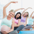 pregnant women in yoga class sitting on mats stretching arms stock photo © wavebreak_media