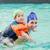 cute little boy learning to swim with coach stock photo © wavebreak_media