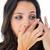 улыбающаяся · женщина · контактная · линза · изолированный · белый · глаза · лице - Сток-фото © wavebreak_media