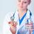 orvos · tart · tabletták · kamerába · boldog · mosolyog - stock fotó © wavebreak_media