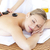 pretty young woman receiving a massage with hot stone stock photo © wavebreak_media