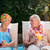 mature couple drinking a cocktail beside the swimming pool stock photo © wavebreak_media
