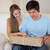 Couple looking at a package in their living room stock photo © wavebreak_media
