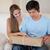 couple · regarder · paquet · salon · maison · lettre - photo stock © wavebreak_media