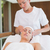 Peaceful brunette getting facial massage from beauty therapist stock photo © wavebreak_media