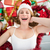 smiling woman laying on the floor with gifts and garland stock photo © wavebreak_media
