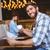 fiatalember · olvas · újság · kávéház · férfi · hírek - stock fotó © wavebreak_media