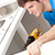 confident man holding a drill repairing a kitchen sink stock photo © wavebreak_media