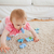 lovely blond baby playing with puzzle pieces on a carpet in the living room stock photo © wavebreak_media