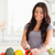 beautiful woman cooking vegetables while standing in the kitchen stock photo © wavebreak_media