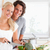beautiful couple cooking while looking at the camera stock photo © wavebreak_media