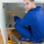Portrait of a young repair man measuring something in a kitchen stock photo © wavebreak_media