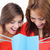 dois · adolescentes · olhando · bolsa · de · compras · branco · compras - foto stock © wavebreak_media