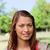 Frau · lächelnd · Aussehen · gerade · vor · sonnig · Umwelt - stock foto © wavebreak_media
