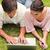 zwei · Freunde · lächelnd · beobachten · etwas · Laptop - stock foto © wavebreak_media