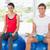 Couple lifting dumbbells while sitting on fitness balls in gym stock photo © wavebreak_media