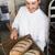 счастливым · Бейкер · лоток · свежие · хлеб - Сток-фото © wavebreak_media
