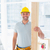 sorridente · masculino · carpinteiro · edifício - foto stock © wavebreak_media