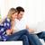 Animated couple using a laptop sitting on sofa at home stock photo © wavebreak_media