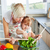 Mother and daughter preparing a salad in kitchen stock photo © wavebreak_media